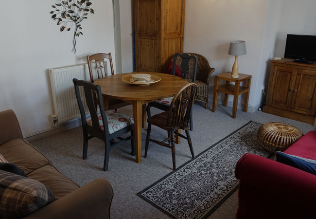 Lounge and dining area in self-catering accommodation in Bangor-on-Dee